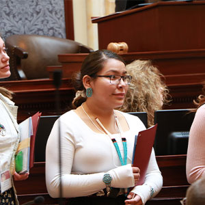 Leyonah Endischee on the Senate floor with other student finalists.
